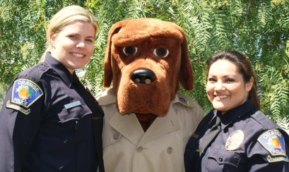 From left to right: Orange Police Dispatchers Clark, Ramos (as McGruff), and Laguna.