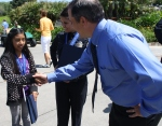 Anaheim Police Communications Manager Kurt Wallace congratulates Paula.